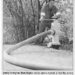 Firefighter Dave Boylan cranks open a hydrant