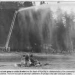 A Comox fire truck sprays a curtain of water over the beach